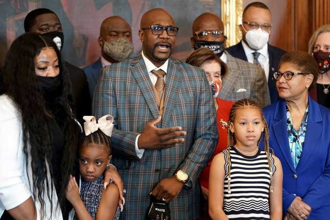 Philonise Floyd (C), brother of George Floyd, and members of his family, delivers remarks Tuesday during a meeting with Speaker of the House Nancy Pelosi at the U.S. Capitol in Washington, D.C., to mark the one year since his killing. Pool Photo by Greg Nash/UPI
