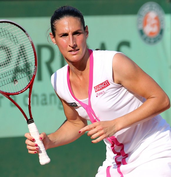 Virginie Razzano, shown at last year's French Open, had one of the four upsets in Tuesday's play at the WTA's Strasbourg International tennis tournament. UPI/David Silpa