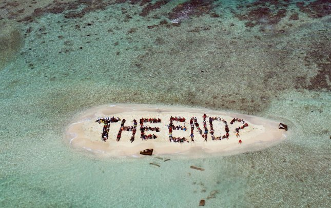 Hundreds of international supporters gather to form a human banner asking if the end is near for the Belize and other endangered coral reefs around the world, on an island on the Belizian Barrier Reef off the coast of Belize City, Belize, on November 13, 2010. The action was on the final day of the three-day Belize Reef Summit which urged global leaders to take strong action at the upcoming U.N Climate Talks in Cancun, Mexico. UPI/Lou Dematteis/Spectral Q