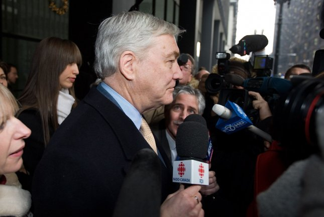 Conrad Black leaves a courtroom in Chicago Dec. 10, 2007, with his daughter Alana..(UPI Photo/Brian Kersey)