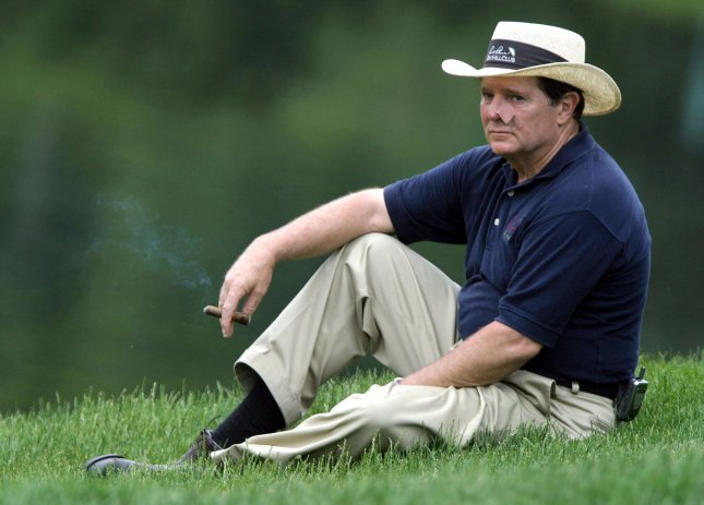 Representative Tom Delay (R-TX) takes a break after putting on the 17th hole at the Booz Allen Classic Pro-Am, held at the Congressional Country Club in Potomac, Maryland, on June, 8, 2005. Delay was teamed up with PGA Tour golfer Chad Campbell. (UPI Photo/Kevin Dietsch)