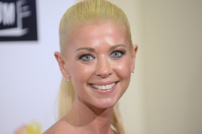 Cast member Tara Reid attends a screening of Sharknado 2: The Second One at the Regal Cinemas LA Live Theater in Los Angeles on Aug. 21, 2014. Photo by Phil McCarten/UPI
