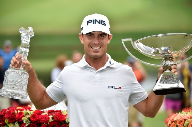 Billy Horschel holds the trophies for the FedEx Cup (R) and PGA Tour Championship after winning both at the East Lake Golf Club in Atlanta Sept. 14, 2014. The victories earned Horschel $11.4 million.. File Photo by David Tulis/UPI
