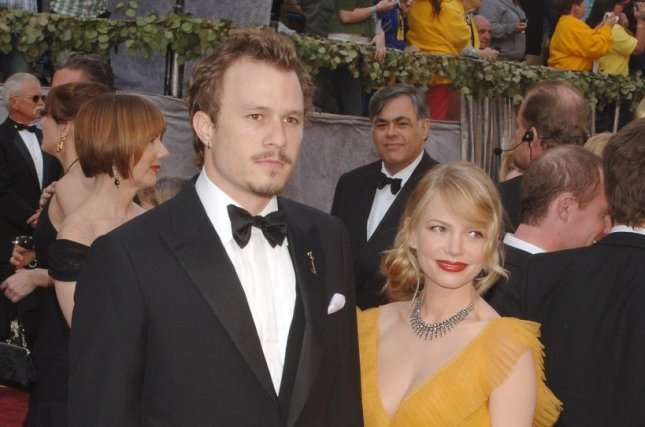 Michelle Williams (R) and Heath Ledger at the Academy Awards on March 5, 2006. File Photo by Jim Ruymen/UPI