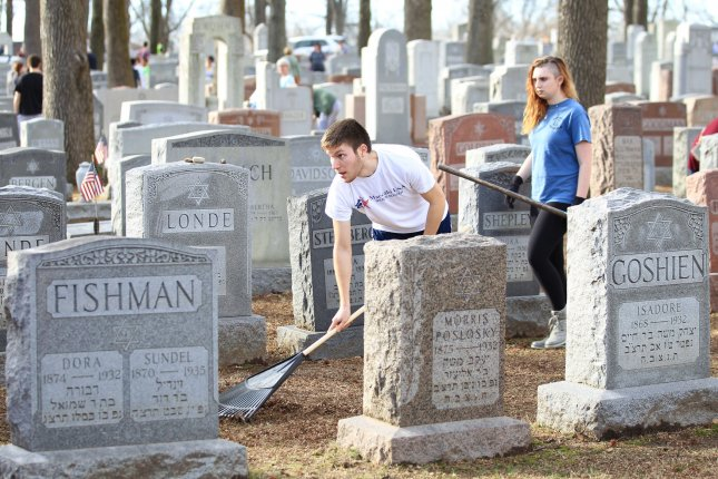Volunteers help clean Chesed Shel Emeth Cemetery in University City, Missouri on February 22, where vandals toppled nearly 200 headstones on February 20. A report released Monday by the Anti Defamation League said incidents of assault, vandalism and harassment of Jewish people and institutions in the United States increased in the first quarter of 2017. Photo by Bill Greenblatt/UPI