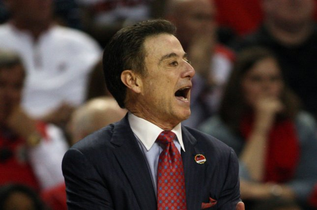 Louisville head coach Rick Pitino sends signals to his players during a game with UC Irving at the 2015 NCAA Men's Basketball Tournament in Seattle, Washington. File Photo by Jim Bryant/UPI