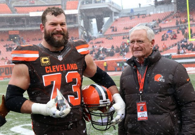 Former Cleveland Browns offensive lineman Joe Thomas stands with team owner Jimmy Haslam after being named the 2016 Walter Payton Man of the Year. Photo by Aaron Josefczyk/UPI