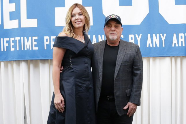 Billy Joel (R), pictured with Alexis Joel, rang in his birthday with Alexis and his daughters Thursday. File Photo by John Angelillo/UPI
