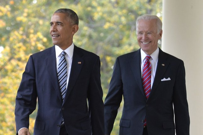 President Barack Obama and Vice President Joe Biden walk along the White House Colonnade on November 9, 2016. File Photo by Mike Theiler/UPI
