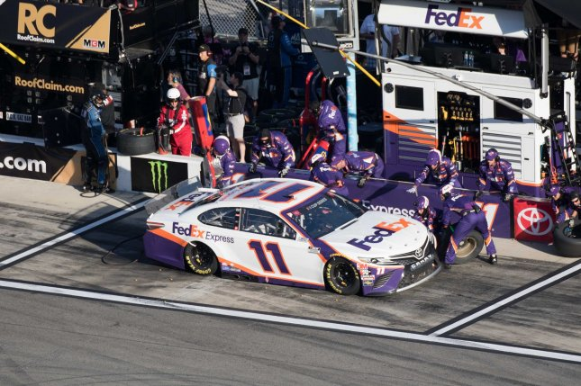 Denny Hamlin (11) beat Dale Earnhardt Jr. off the final corner Sunday at the virtual Homestead-Miami Speedway track. File Photo by Edwin Locke/UPI
