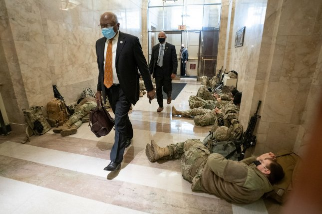 House Majority Whip James Clyburn arrives at the U.S. Capitol in Washington, D.C., on Wednesday, walking by sleeping National Guard members who are guarding the complex ahead of President-elect Joe Biden's inauguration next week. Photo by Kevin Dietsch/UPI