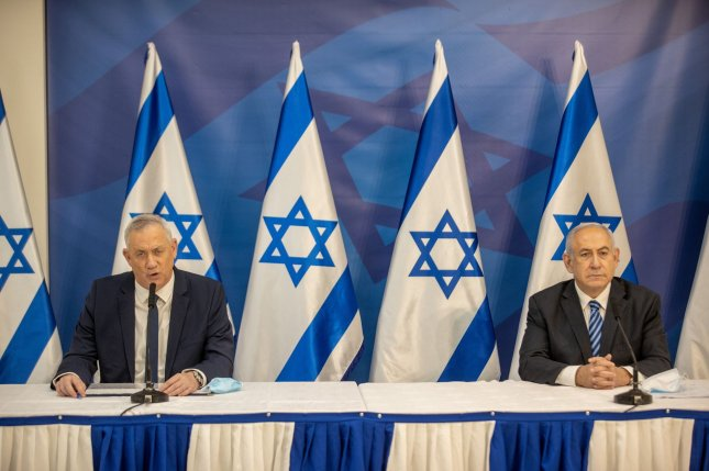 Israeli Prime Minister Benjamin Netanyahu and defense minister Benny Gantz are seen together during a news conference on July 27, 2020, in Tel Aviv, Israel. File Photo by Tal Shahar/UPI
