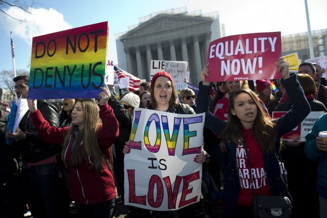 Same-sex marriage supporters rally in front of the U.S. Supreme Court as the Court hears arguments on same-sex marriage, in Washington, D.C. on March 26, 2013. The Supreme Court is hearing arguments on Califonia's ban on same-sex marriage. UPI/Kevin Dietsch