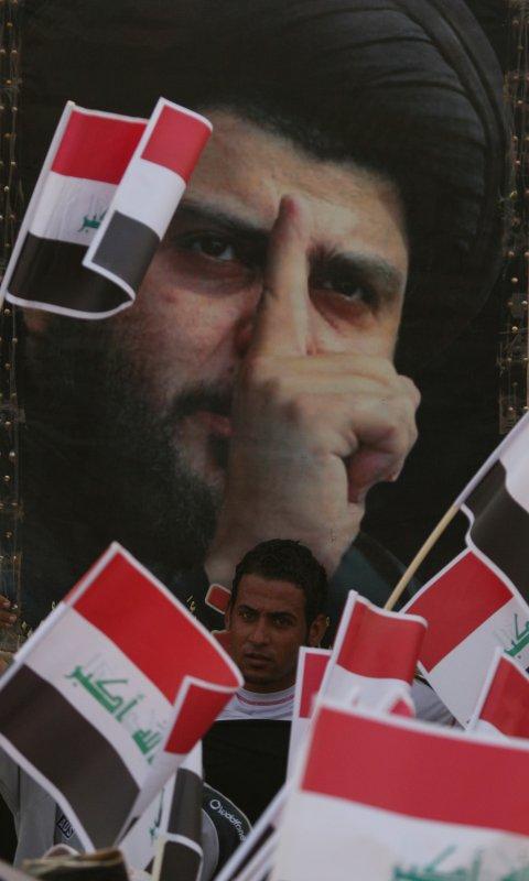 Supporters of Shi'ite cleric Moqtada al-Sadr demonstrate against the visit of U.S. Defense Secretary Robert Gates in Sadr City, Baghdad, on July 28, 2009. (UPI Photo/Ali Jasim)