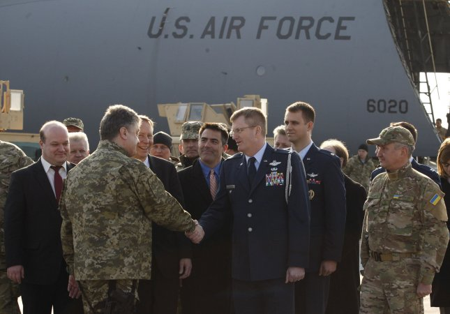 Ukrainian President Petro Poroshenko, left, greets the U.S. delegation during a welcome ceremony for the United States' first shipment of non-lethal military equipment to Ukraine. Photo by Ivan Vakolenko/UPI