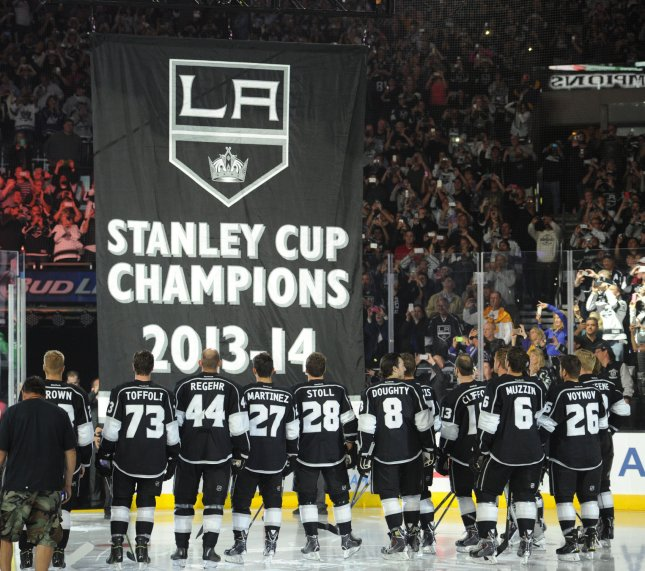 The Los Angeles Kings watch the Stanley Cup banner rise to the rafters in LA's Staples Center in a ceremony before a game Oct. 6, 2014. The Kings won the cup, their second in three years, in a double-overtime game against the New York Rangers June 13, 2014. File Photo by Lori Shepler./UPI