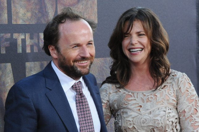 Rupert Wyatt, who directed the motion picture sci-fi thriller Rise of the Planet of the Apes, arrives with his wife Erica for the premiere of the film at Grauman's Chinese Theatre in Los Angeles on July 28, 2011. Wyatt announced Wedensday that he was dropping out of directing the 'X-Men' spinoff 'Gambit.' File Photo by UPI/Jim Ruymen