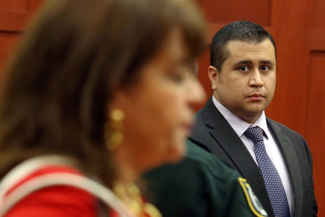 George Zimmerman looks at Florida prosecutor Angela Corey during his trial in 2013. Zimmerman states in his auction for the 9mm pistol used to kill Trayvon Martin that he would use part of the proceeds of the sale to derail Corey's career. Photo by Jacob Langston/Pool/UPI