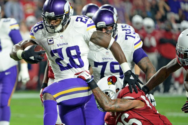 Minnesota Vikings running back Adrian Peterson heads to the end zone for a touchdown in the first quarter of the Vikings-Arizona Cardinals game at University of Phoenix Stadium in Glendale, Arizona, December 10, 2015. Photo by Art Foxall/UPI