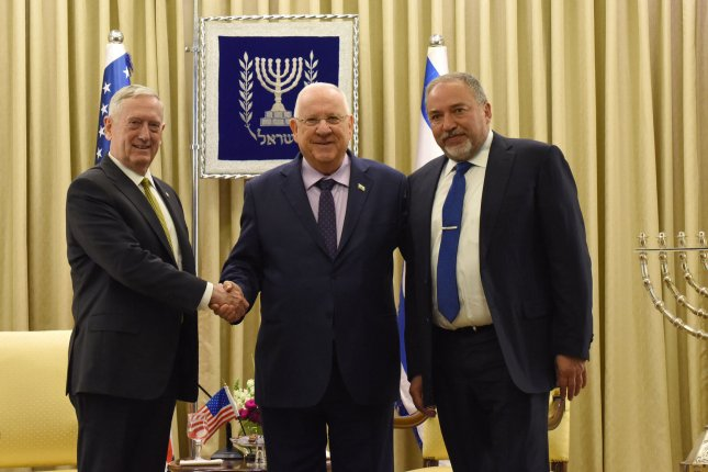 U.S. Secretary of Defense James Mattis (L) shake hands with Israeli President Reuven Rivlin (C) with Israeli Defense Minister Avigdor Libeman (R)at the president's residence in Jerusalem on Friday. Photo by Debbie Hill/UPI