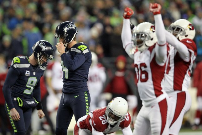Arizona Cardinals special teams celebrates as Seattle Seahawks holder Jon Ryan (9) and Seattle Seahawks kicker Steven Hauschka (4) hang their heads after missing an extra point, which would have put the Seahawks ahead at CenturyLink Field in Seattle, Washington on December 24, 2016. File photo by Jim Bryant/UPI