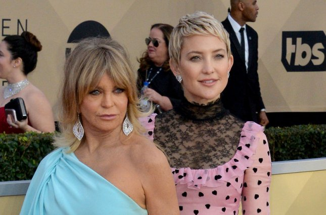 Goldie Hawn (L) and Kate Hudson reflected on the importance of family after posing for People's Beautiful issue with Hudson's daughter, Rani Rose. File Photo by Jim Ruymen/UPI