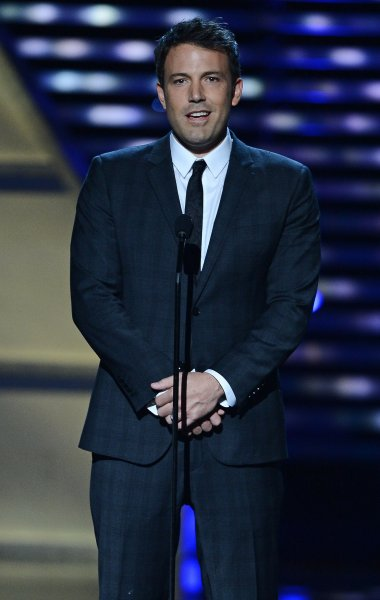 Actor Ben Affleck presents Team Hoyt comprised of father and son Dick and Rick Hoyt with the Jimmy V Perseverance Award at the 2013 ESPY Awards show at the Nokia Theatre L.A. Live in Los Angeles on July 17, 2013. The 20th annual ESPY's honor the best in sports in the past year. UPI/Jim Ruymen