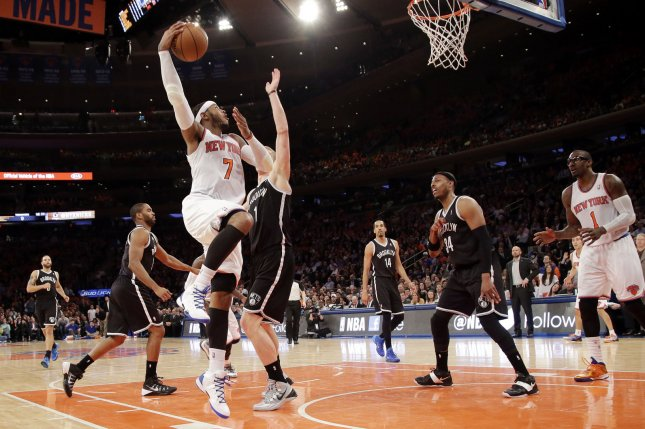 New York Knicks Carmelo Anthony shoots a hook shot in the second half against the Brooklyn Nets at Madison Square Garden in New York City on April 2, 2014. The Knicks defeated the Nets 110-81. UPI/John Angelillo