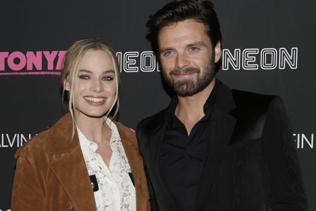 Margot Robbie (L) and Sebastian Stan arrive on the red carpet at the I, Tonya New York premiere on November 28. Photo by John Angelillo/UPI