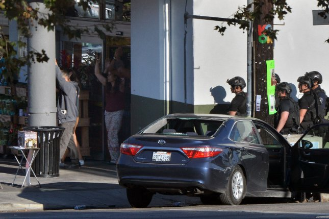 Los Angeles supermarket gunman in custody after police chase