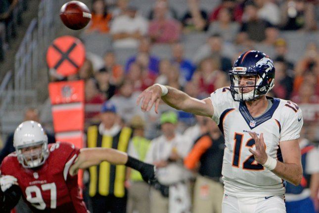 Former Denver Broncos quarterback Paxton Lynch (12) throws a pass in the second quarter of the Broncos-Arizona Cardinals game on September 1, 2016 at University of Phoenix Stadium in Glendale, Arizona. File photo by Art Foxall/UPI