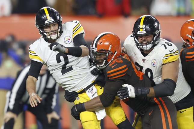Pittsburgh Steelers quarterback Mason Rudolph (2) is hit by Cleveland Browns defensive lineman Myles Garrett (95) during the second half on Thursday night at FirstEnergy Stadium in Cleveland. Photo by Aaron Josefczyk/UPI