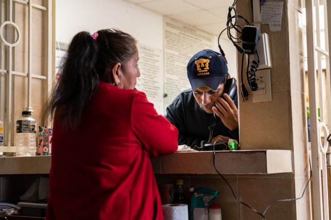 A migrant makes a phone call at a shelter in Matamoros, Mexico, on January 25, 2019. Some at the shelter were living in the United States and deported after the Trump administration said it would begin sending asylum-seekers back to their native countries. File Photo by Ken Cedeno/UPI