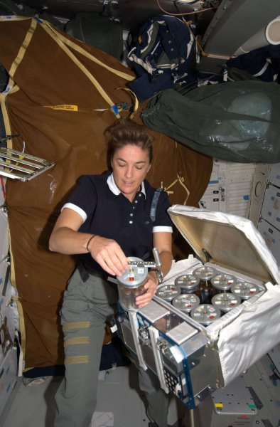 NASA Astronaut Heidemarie Stefanyshyn-Piper, STS-126 mission specialist, works with Group Activation Packs (GAP) on the middeck of Space Shuttle Endeavour while docked with the International Space Station on November 19, 2008. (UPI Photo/NASA)