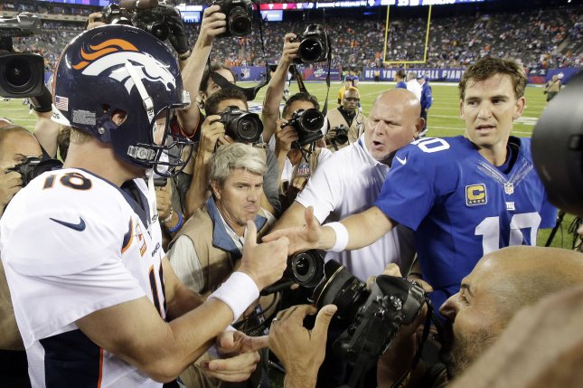 New York Giants' Eli Manning and Denver Broncos' Peyton Manning, facing off in New Jersey in 2013. File Photo by John Angelillo/UPI