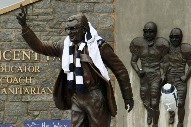 A statue of Joe Paterno, the football coach with the most wins in college football history, was removed in 2012 following the child sexual abuse scandal involving Paterno's former assistant Jerry Sandusky. Presidential candidate Donald Trump made a confusing comment Wednesday about bringing the statue back. File Photo by George Powers/UPI