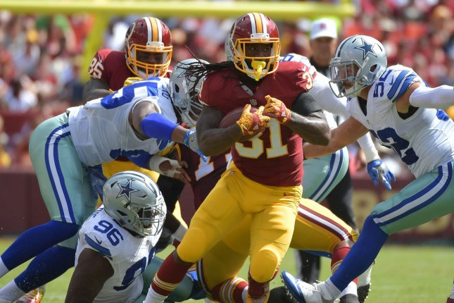 Former Washington Redskins running back Matt Jones (31) runs against the Dallas Cowboys in the second quarter on September 18, 2016 at FedEx Field in Landover, Maryland. File photo by Kevin Dietsch/UPI
