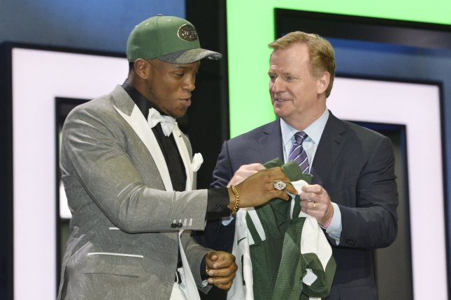 New York Jets linebacker Darron Lee (L) receives his jersey from NFL Commissioner Roger Goodell after being selected by the New York Jets with the 20th overall pick in the 2016 NFL Draft on April 28, 2016 in Chicago. File photo by Brian Kersey/UPI