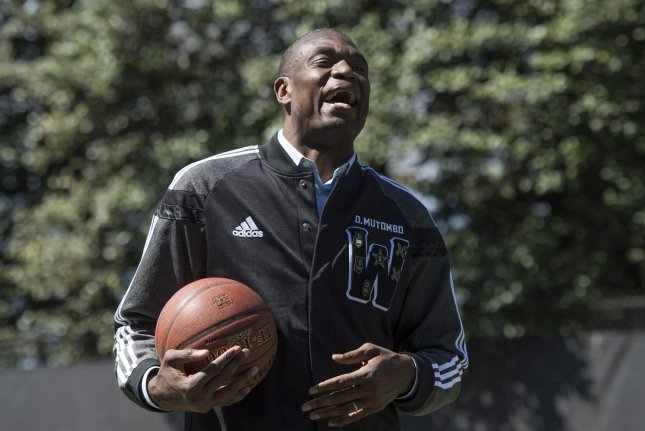 Retired NBA player Dikembe Mutombo laughs during the Easter egg roll at the White House hosted by President Barack Obama on April 21, 2014. Mutombo said Saturday it was a dream come true the NBA will launch a league in Africa. File photo by Kevin Dietsch/UPI