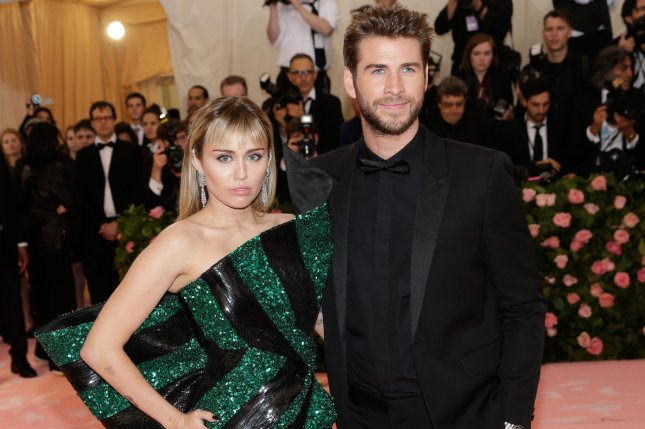 Miley Cyrus (L) with her husband Liam Hemsworth. Cyrus has released the first of three planned EP's on Friday. Photo by John Angelillo/UPI