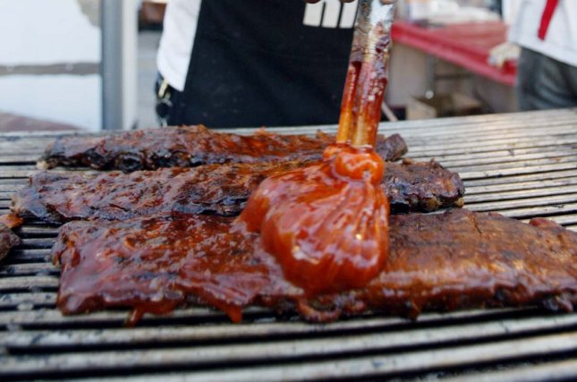 Reynolds Wrap announced it is seeking a Chief Grilling Officer to travel the country for two weeks sampling barbecue ribs and learning about different grilling techniques. File Photo by Bill Greenblatt/UPI