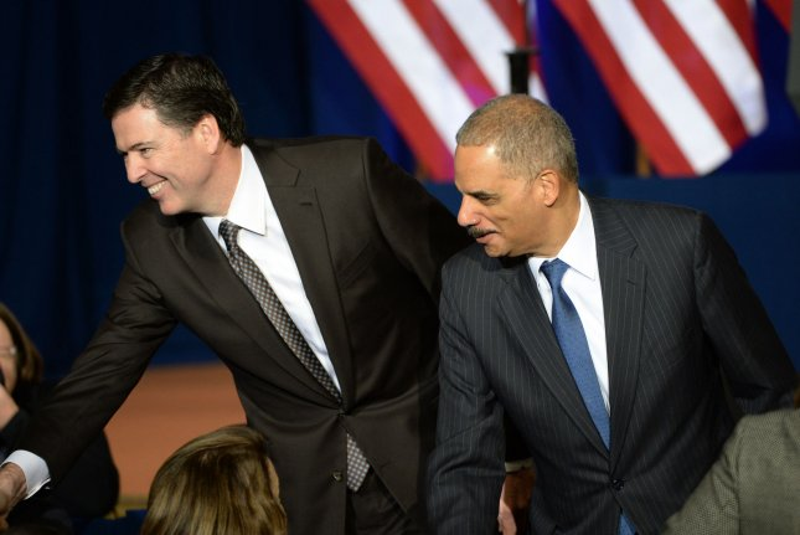 U.S. Attorney General Eric Holder (R) and FBI Director James Comey. UPI/Pat Benic