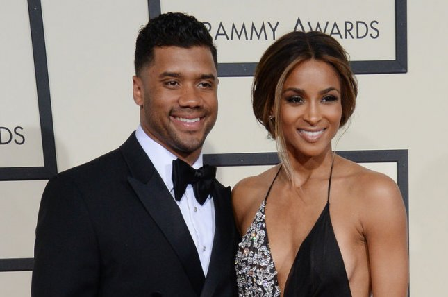 Ciara (R) and Russell Wilson at the Grammy Awards on February 15. The couple announced their engagement Friday. File Photo by Jim Ruymen/UPI