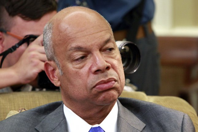 Homeland Security Secretary Jeh Johnson appears at a national security meeting in the Oval Office in July. Johnson said Thursday his department is consideirng whether to classify the nation's election apparatus critical infrastructure requiring the same level of cyber-protection as the power grid and the financial sector. Pool photo by Dennis Brack/UPI