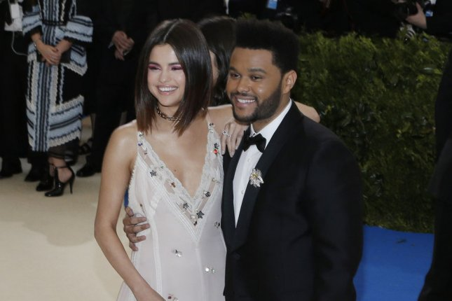 Selena Gomez (L) and The Weeknd attend the Costume Institute Benefit at the Metropolitan Museum of Art on May 1. The actress sang and danced along at The Weeknd's show Tuesday in New York. File Photo by John Angelillo/UPI