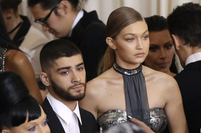 Zayn Malik (L) and Gigi Hadid attend the Costume Institute Benefit at the Metropolitan Museum of Art on May 2, 2016. The singer's mom shared a picture of Malik showing off his freshly-shaved head Sunday. File Photo by John Angelillo/UPI