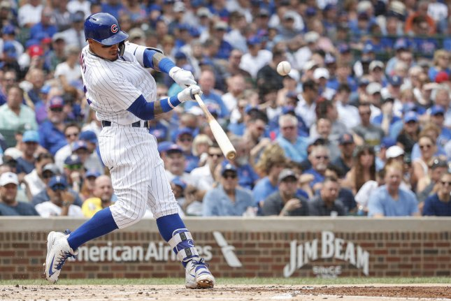 Chicago Cubs slugger Javier Baez helped his team beat the Cincinnati Reds on Thursday at Wrigley Field in Chicago. Photo by Kamil Krzaczynski/UPI