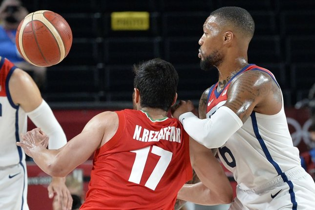 Team USA's Damian Lillard (R) fights for the ball in a group stage game against Iran at the 2020 Summer Games on Wednesday in Saitama, Japan. Photo by Mike Theiler/UPI