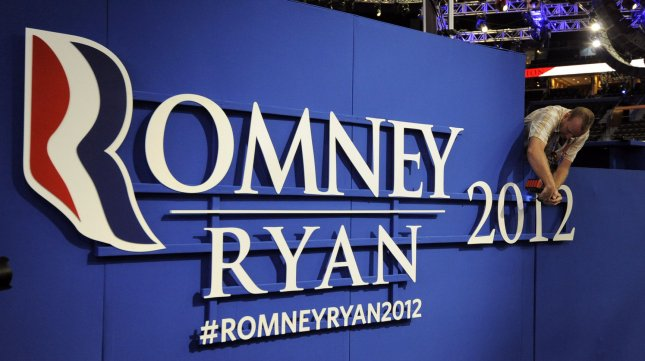 A worker adjusts a Romney Ryan sign in preparation for the upcoming Republican National Convention at the Tampa Bay Times Forum on August 26, 2012 in Tampa Bay, Florida. UPI/Mike Theiler