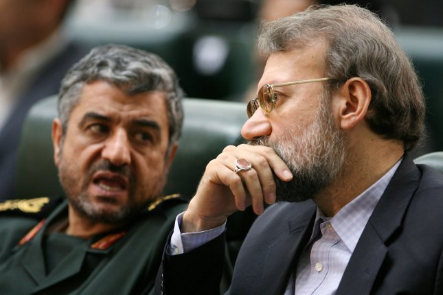 Iran's former chief nuclear negotiator Ali Larijani (R) listens to the head of the Revolutionary Guard Mohammad Ali Jafari while they listen to Iran's President Mahmoud Ahmadinejad during the opening ceremony of Iran's 8th parliament in Tehran, Iran on May 27, 2008. Iran's former chief nuclear negotiator Ali Larijani is to become the next speaker in the Iranian parliament, Tehran media reported Monday. Larijani is also expected to run again in the 2009 presidential elections and be one of the main challengers to Ahmadinejad. (UPI Photo/Mohammad Kheirkhah)